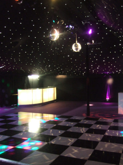 Black and white dance floor and illuminated bar